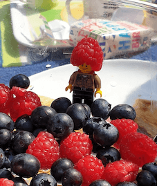 Camping in the garden - lego man with raspberry on head